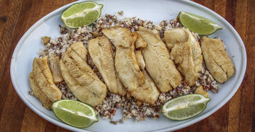 Serve the grilled fish over a bed of rice with extra lime to squeeze on at the table.