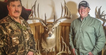 Milo Hanson and Mike Hanback with Hanson's world-record whitetail.