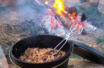 Simmer the Easy Camp Carnitas in a Dutch oven over the fire for an easy, and delicious, camp meal.