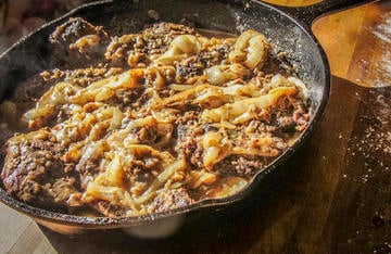A skillet full of fried venison liver with onion gravy might make you rethink leaving your deer liver in the woods.