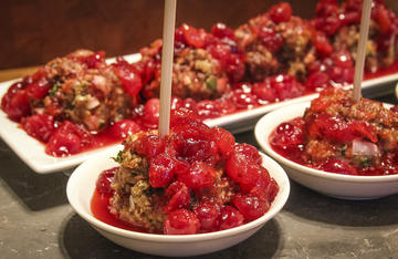 You can serve the meatballs in individual bowls with a wooden skewer for easy transportation and eating at a party.