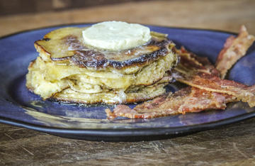 Pancakes filled with flavorful pawpaws and topped with homemade butter make the perfect breakfast.