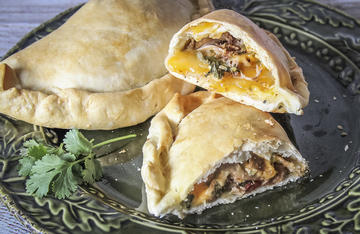 Tender slow cooked squirrel meat pairs perfectly with southwestern flavors when stuffed into the flaky crust of this hand pie.