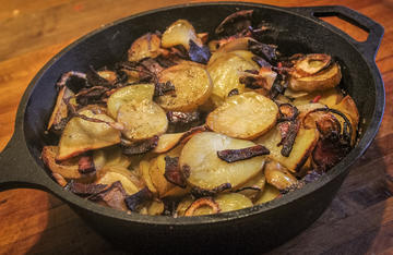 Creamy potatoes with crispy venison bacon make an excellent side dish for any wild game.