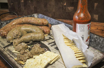 Grill or pan fry the boudin and eat it like a sausage, or boil or steam it and squeeze it out onto a cracker.
