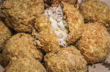 Crunchy fried boudin balls filled with melted pepper jack cheese are a hit at any party or deer camp.