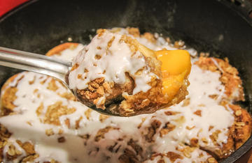 Who can resist the mixture of baked cinnamon rolls and peach cobbler?