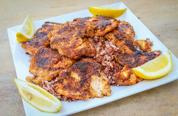Serve the blackened fish with rice and fresh lemon wedges for squeezing.