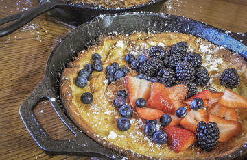 Serve the Dutch Baby Pancakes with a sprinkle of powdered sugar, a drizzle of syrup, and even your favorite fresh fruits.