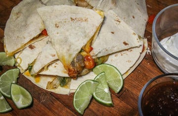 Serve the quesadillas with salsa, sour cream, fresh lime.