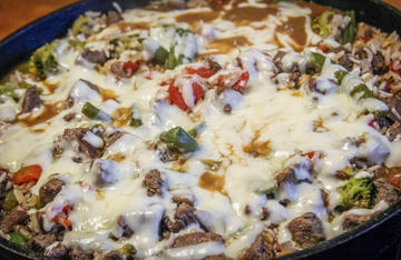 Venison, vegetables and rice make a complete meal in one skillet, the gooey melted cheese makes it taste even better.