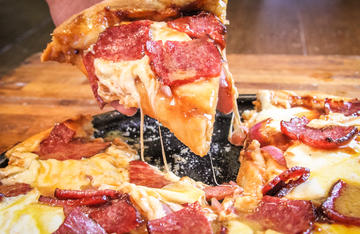 Sweet BBQ sauce, grilled red onions, and venison bacon make for a great pizza.