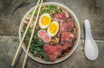 Serve the ramen bowl with a soft boiled, marinated egg and whatever vegetables you prefer.