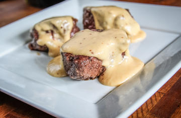 Pan-seared backstrap is even better when topped with a creamy beer cheese sauce.