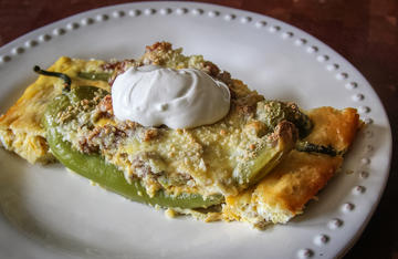 Top this cheesy, spicy breakfast dish with a dollop of sour cream before serving.