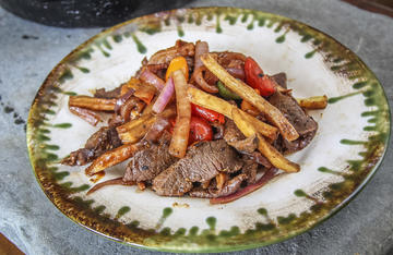 French fries, hot peppers, tomatoes and onions pair perfectly with sliced venison.