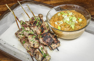 It's hard to go wrong with meat on a stick, especially with this tender grilled venison satay and peanut dipping sauce.