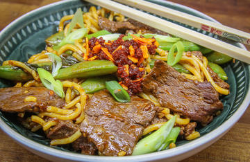 A quick and easy sliced venison stir-fry flavored with garlic and chili crisp