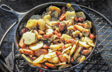 A camp favorite of skillet-fried potatoes gets even better when you add Realtree Smoked Sausage.