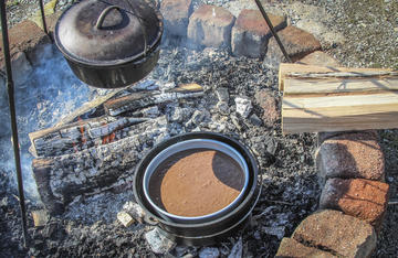 Using a smaller baking pan inside your Dutch oven makes clean up quick and easy.