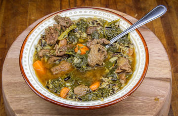 Tender elk meat, wild rice, potatoes, carrots, and kale make a hearty stew to warm you up on a cold winter's night.