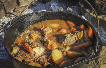 A good elk roast is hard to beat when slow simmered over a campfire with onions, potatoes, and carrots.