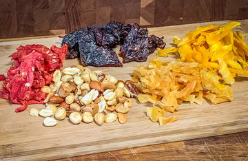 Venison jerky, nuts, and dried fruits combine to make a hunting snack with tropical flavor.