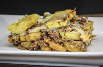Savory ground venison and strips of sweet fried plantain combine for a version of this classic Puerto Rican comfort food.