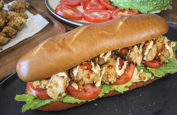 Piled high with spicy, crispy bits of deep fried turkey, this Po' boy will satisfy a hunter's hunger.