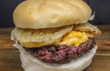 Top a grilled venison burger with fried green tomato slices and pimento cheese for even more flavor.