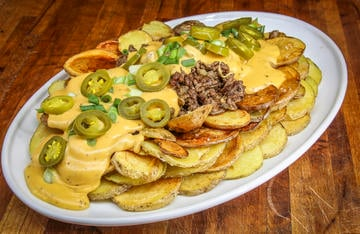 These layers of crispy fried potatoes topped with mounds of ground venison and creamy beer cheese can be served as an appetizer or as a main dish.