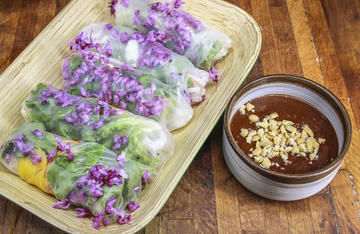 Butter-poached panfish and tart redbud blossoms combine in these springtime rolls