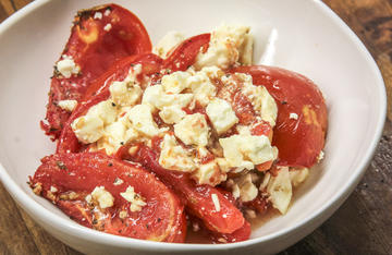 The smoky flavor from our Traeger grill enhances the sweet, vine-ripened tomato, topped with salty feta cheese.