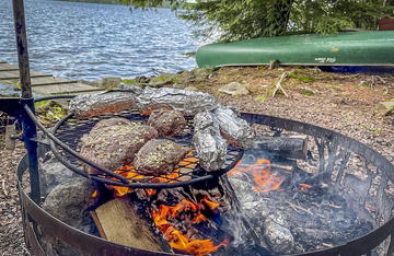 Fresh air and the smoke from a campfire are the perfect seasonings for these E3 steaks.