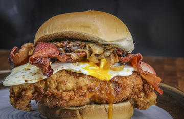 Marinated turkey breast fried in a spicy, crispy coating, topped with bacon, caramelized onions, and a fried egg, makes one of our favorite sandwiches.
