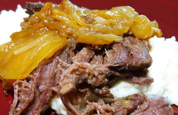 Beer braised elk chuckroast and onions over mashed potatoes. A great way to tenderize what can be a tough cut of meat.