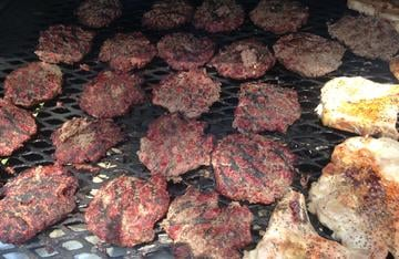 Elk burgers take their place alongside a few pork chops for camp lunch.
