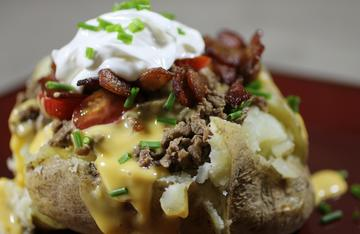 Top a potato with ground venison and your favorite burger toppings.