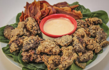 A large platter of fried wild turkey livers make an interesting appetizer or main course.
