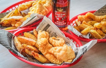 """Serve the fish pub-style with twice fried """"chips"""" in a newspaper lined basket."""