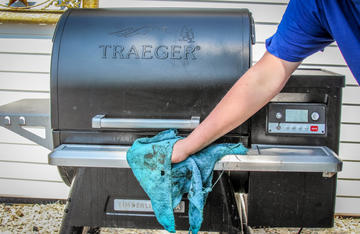 Give the exterior of your grill a good wipe down with a rag soaked with mild cleaner.