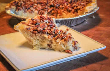 Paw paw custard pecan pie is a rich and creamy dessert with an unusual flavor.