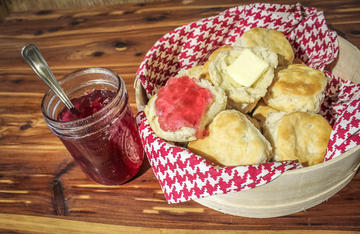 Redbud Jelly has a floral and fruity flavor that is perfect on a hot biscuit.