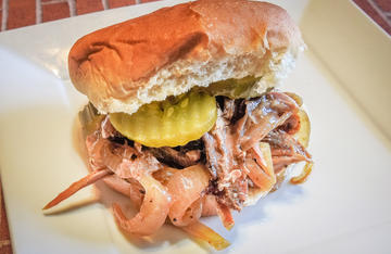 Pile the barbecued squirrel onto a bun and top with a few dill pickles for a crowd pleasing sandwich.