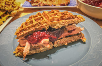Piled high smoked turkey breast topped with homemade cranberry sauce on a cornbread stuffing waffle.