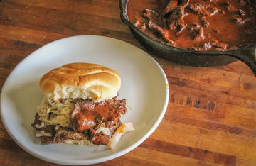 Dr Pepper based BBQ sauce makes this venison sandwich sweet and tangy.