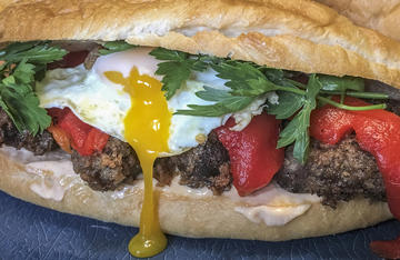 Fried backstrap and a runny fried egg transform this from a standard sandwich into a breakfast treat.