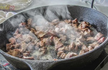 Start by searing diced venison backstrap or tenderloin in a cast iron skillet.