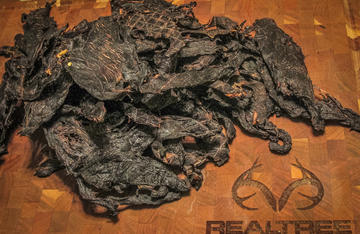 A pile of fresh jerky will fuel a deer camp for days.