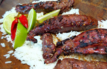 Serve the grilled venison over white rice and add sliced limes and a hot pepper or two for garnish.